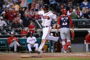 Joey Terdoslavich (GWN 2012-13) scores the winning run on Braeden Schlehuber's 9th-inning single. (Chris Roughgarden)