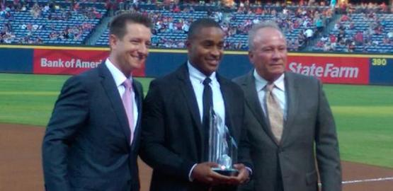 Center fielder Mallex Smith receives his Atlanta Braves' Player of the Year award from Schuerholz (left) and Trembley on Saturday at Turner Field.
